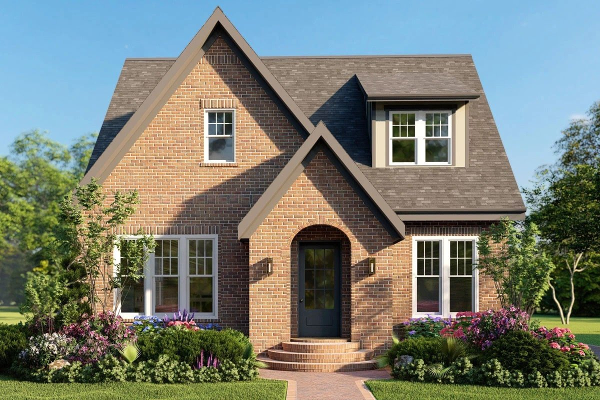 Front rendering of the two-story 5-bedroom modern Tudor home.
