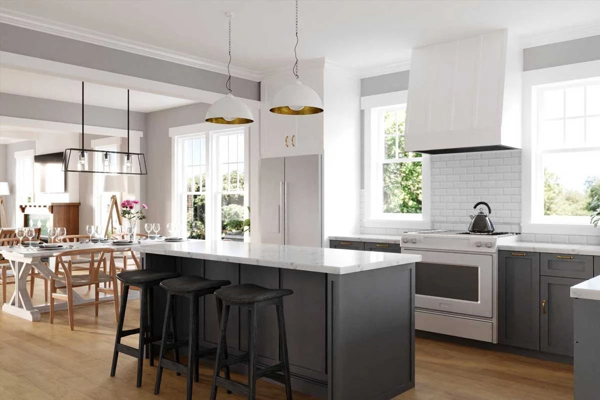 The kitchen is equipped with white appliances, charcoal cabinetry, marble countertops, and a breakfast island.