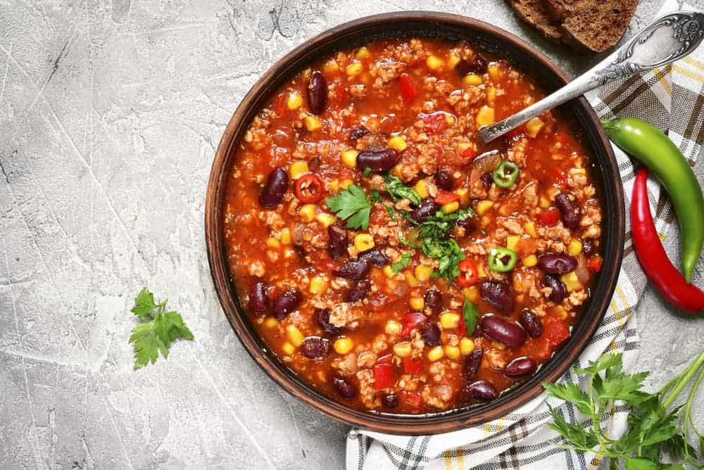 This is a close look at a hearty bowl of chili corn carne.