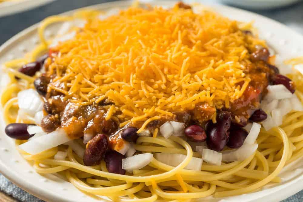 A Cincinnati-Style Chili spaghetti with cheese and onion.