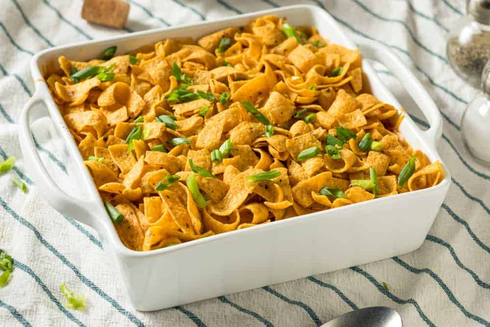 This is a dish of homemade Frito PIe Mexican Casserole with Cheese and Beans.