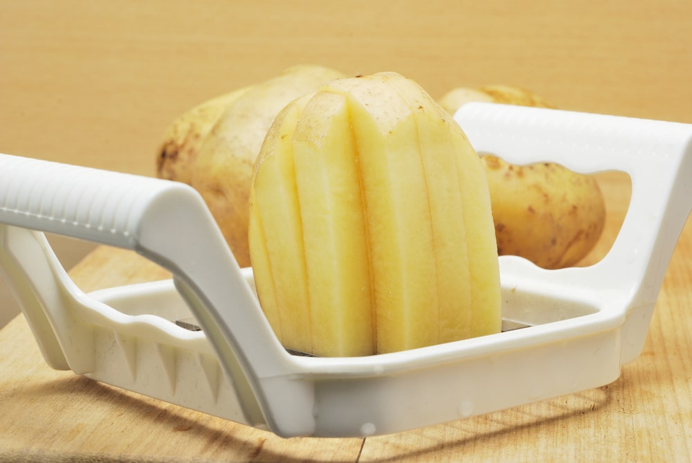 A close look at a potato slicer in action.