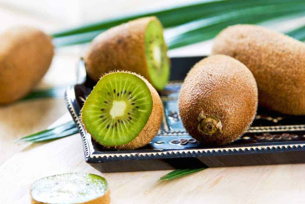 This is a close look at a few sliced Bruno Kiwi on a tray.