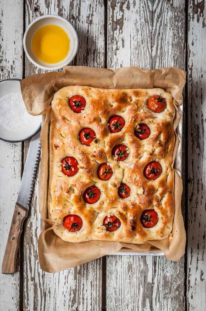 A Cherry Tomato, Rosemary and Garlic Focaccia in a rectangular pie plate.