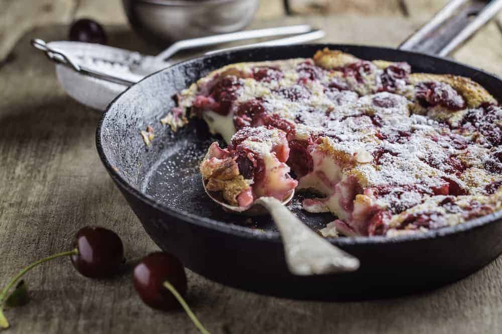A delicious cherry pie cooked in a cast iron pie pan.