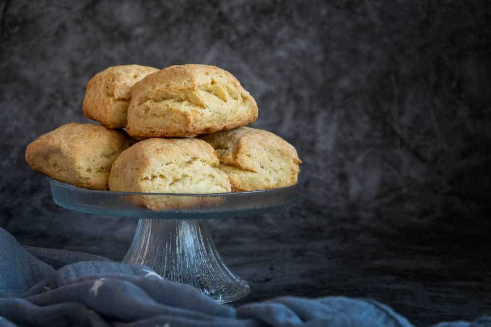 A stack of flaky scones on display.