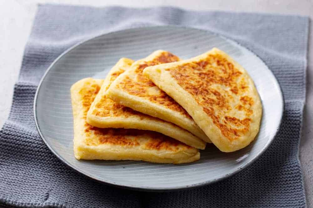 A stack of traditional tattie scones on a plate.