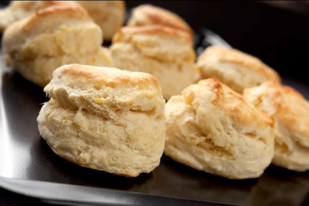 This is a close look at a tray of homemade buttermilk scones.