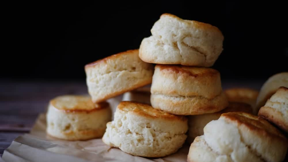 A close look at a pile of homemade butter scones.