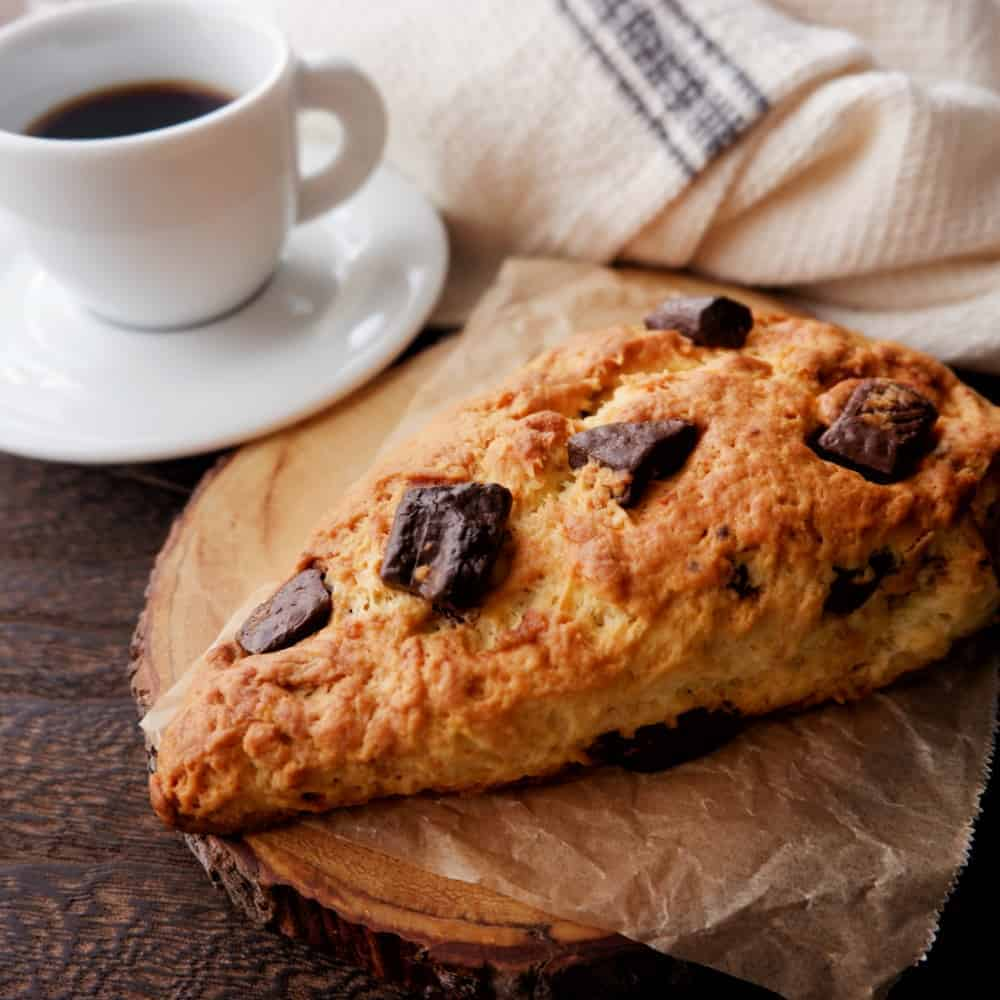 A piece of American scone with a cup of coffee.