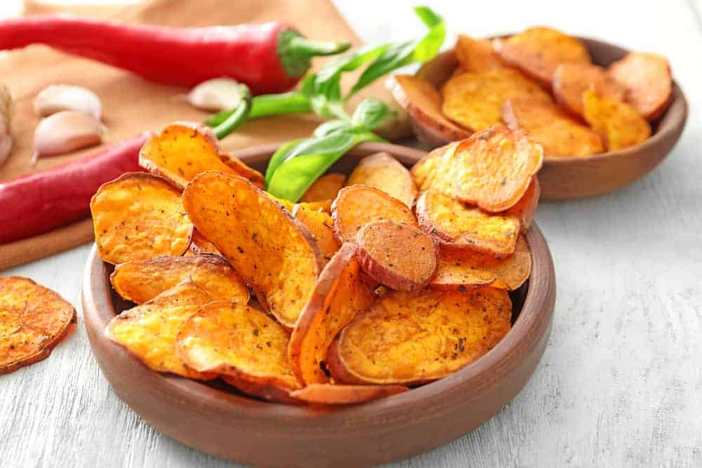 Bowls of crispy sweet potato fries.