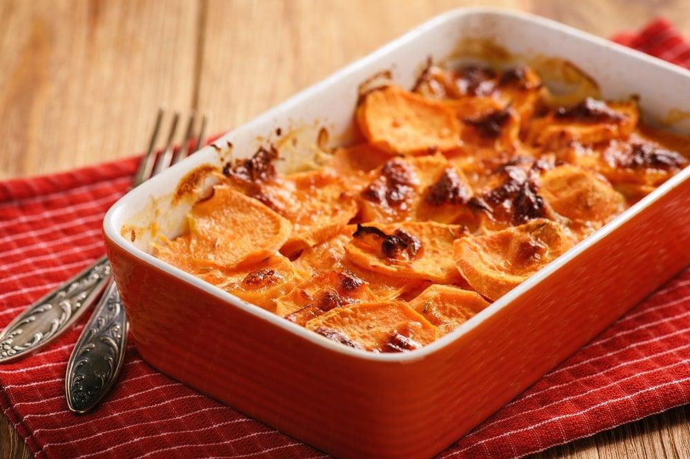 Freshly-baked sweet potato casserole on a wooden table.