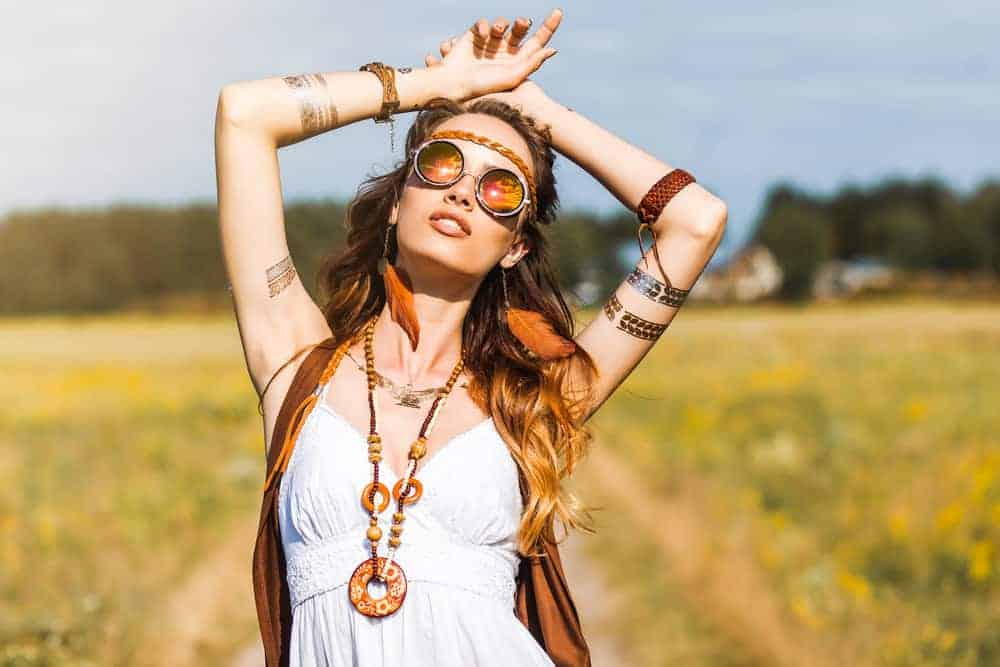 This is a close look at a woman that is wearing a Bohemian-style outfit.