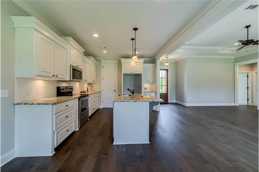 The kitchen includes a walk-in pantry concealed behind the white door.
