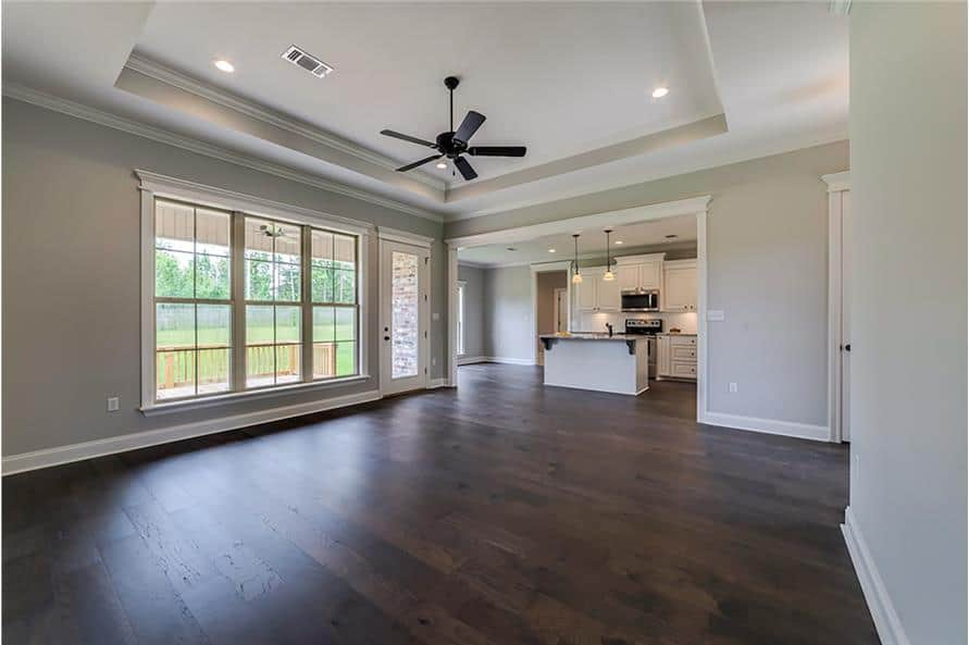 An oversized opening provides a seamless flow from the great room to the eat-in kitchen.