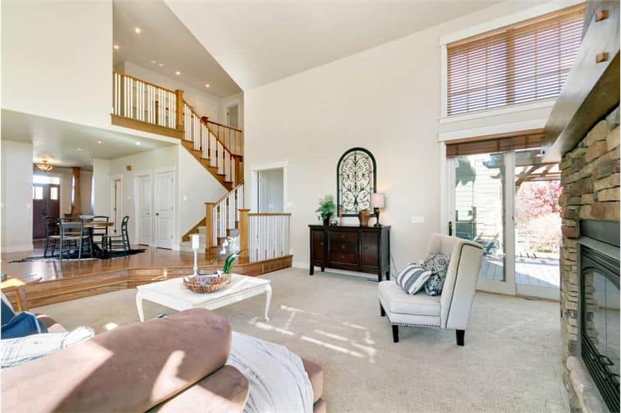 A soaring vaulted ceiling crowns the living room.