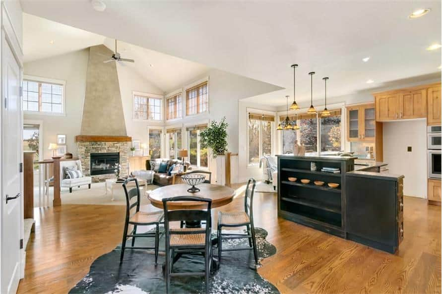 The breakfast area offers a round dining set sitting on a cowhide rug.