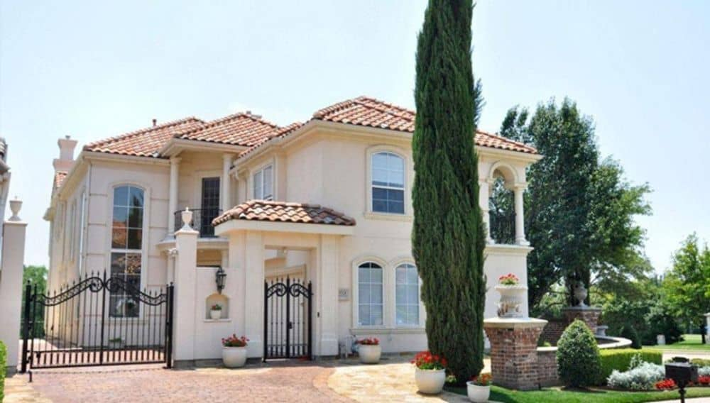 4-Bedroom Two-Story Luxury Mediterranean Home for a Narrow Lot with Balconies