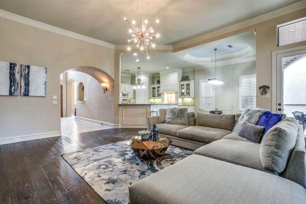 A warm sputnik chandelier illuminates the living room.