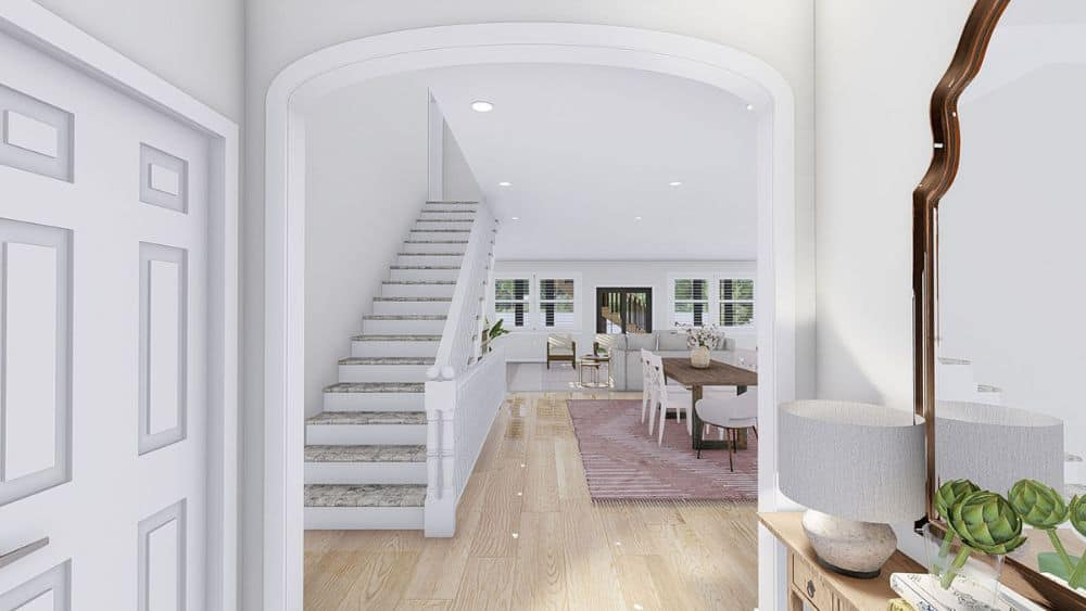 An open archway connects the foyer to the main living space.