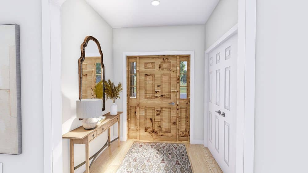 Foyer with a wooden entry door and a matching console table topped with an arched mirror.