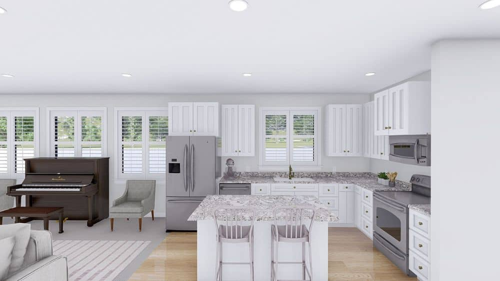 The kitchen offers slate appliances, white cabinetry, and a breakfast island with two seating.