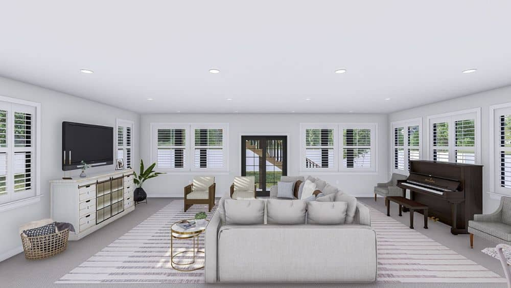 Family room with an L-shaped sectional, cushioned armchairs, an upright piano, and a wall-mounted TV.
