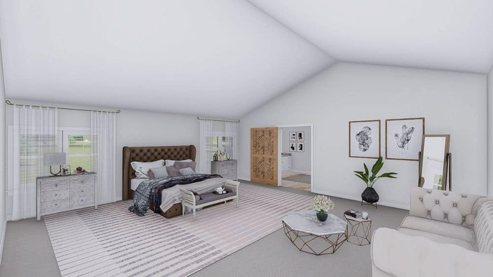 A white vaulted ceiling crowns the primary bedroom.