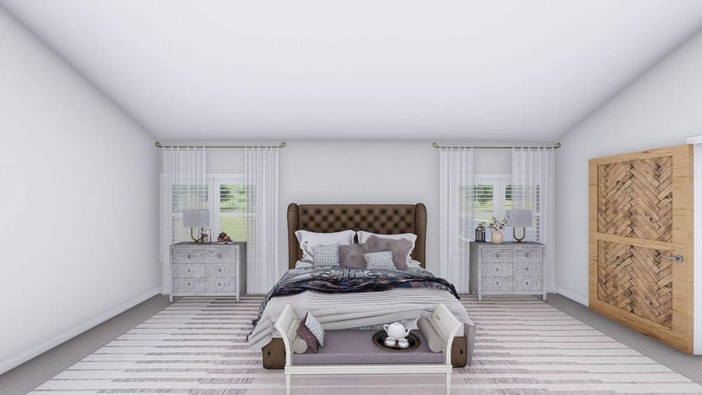 Primary bedroom with a tufted wingback bed flanked by matching nightstands and windows.