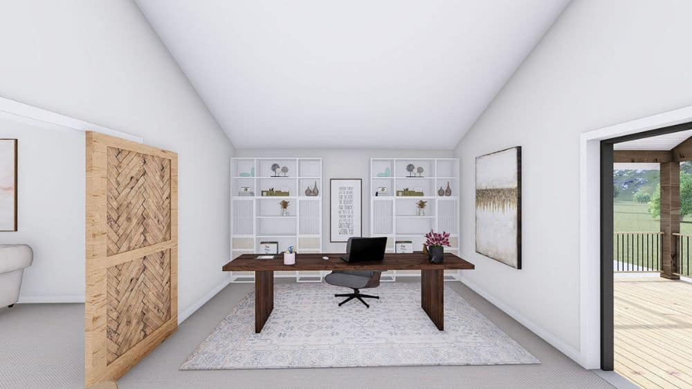 Office with white shelving units, a dark wood desk, and deck access.