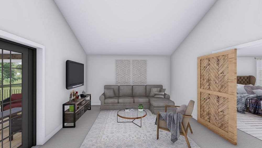 The office includes a sitting area with an L-shaped sectional, a cushioned armchair, and a wall-mounted TV.The office includes a sitting area with an L-shaped sectional, a cushioned armchair, and a wall-mounted TV.