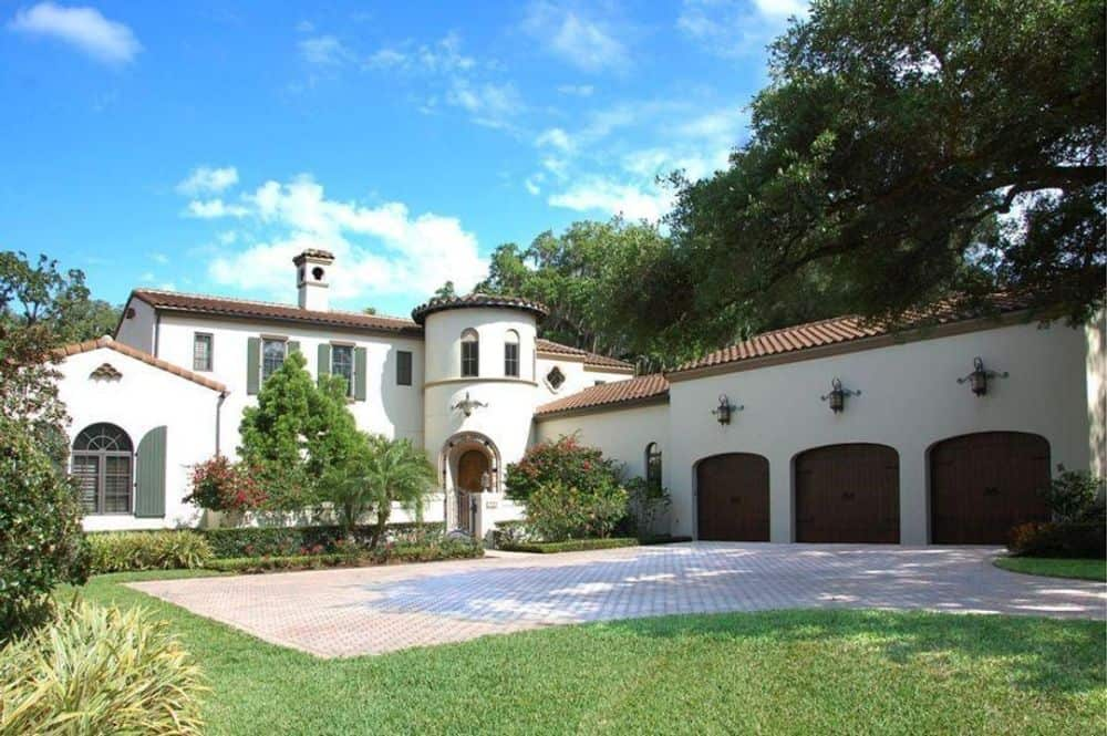 4-Bedroom Two-Story Spanish Style Home with a Courtyard and Balcony