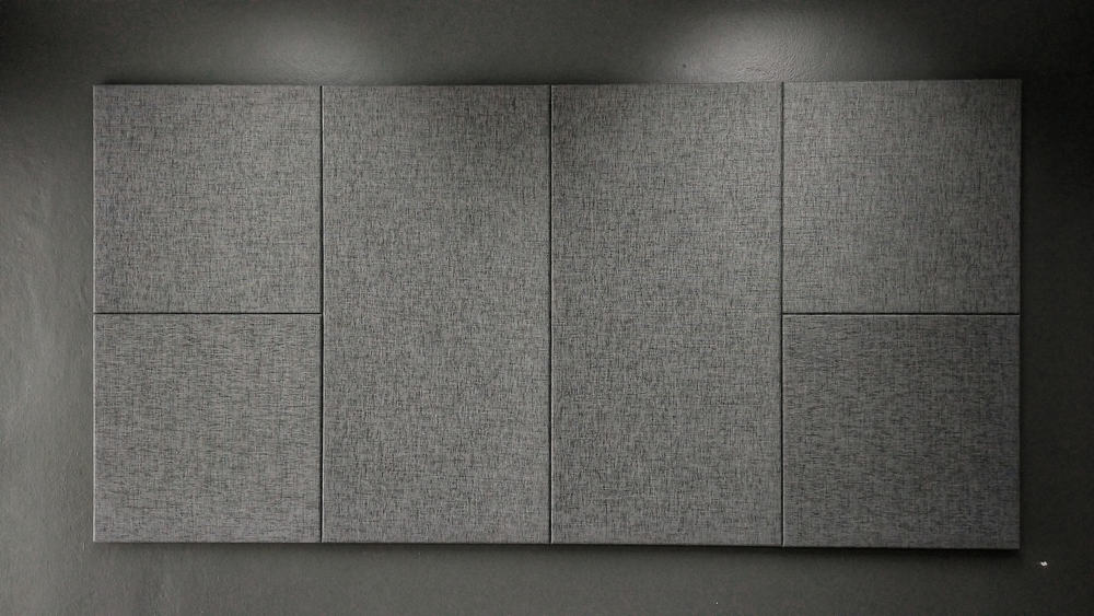 This is a close look at sets of gray acoustic panels that match with the gray wall.
