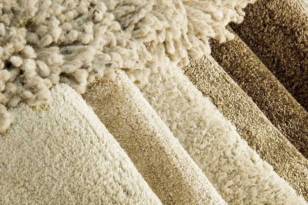 This is a close look at the sets of carpets on display at a store.