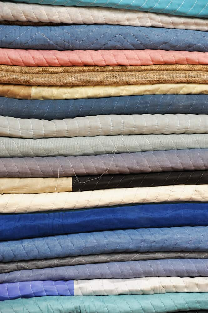 This is a close look at a stack of furniture pads in different colors.