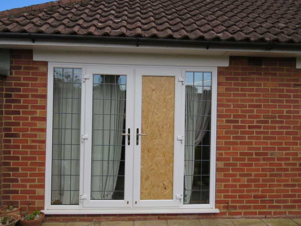 This is an exterior view of the window with one window fitted with homemade window blocker.