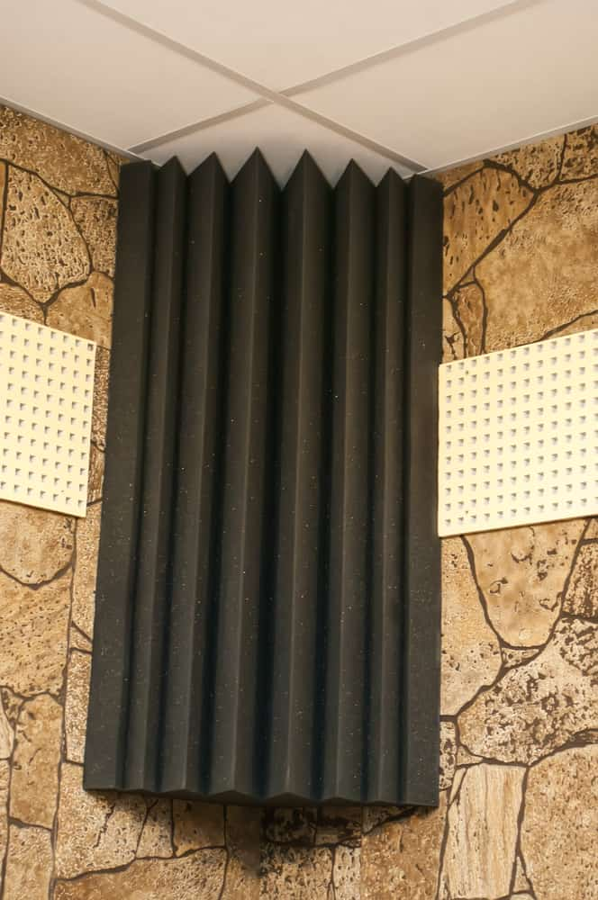 This is a close look at a Corner Acoustic Foam on the stone mosaic wall.
