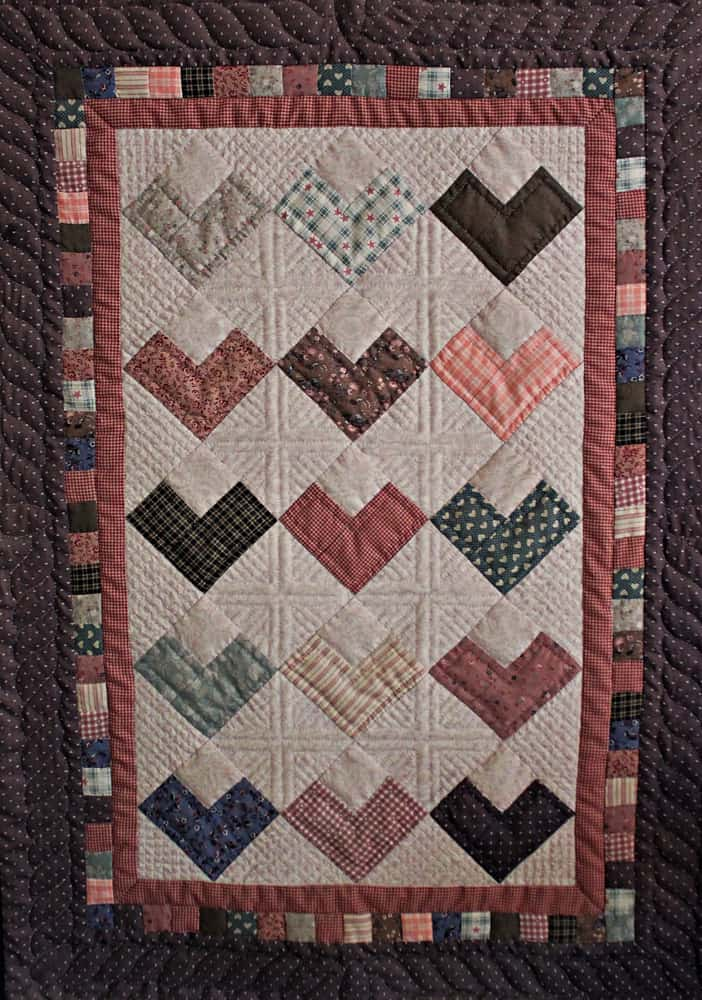 This is a close look at a colorful quilt perfect for wall hanging.