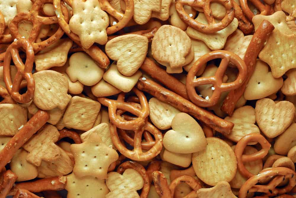 This is a close look at cinnamon sugar snack mix with pretzels and biscuits.