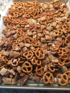 A freshly-baked batch of cinnamon sugar snack mix.