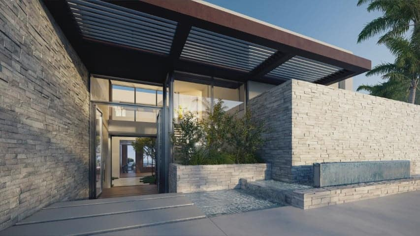 This is the main entrance of the house with gray concrete blocks and a planter by the main entrance to the glass doors. Image courtesy of Toptenrealestatedeals.com.