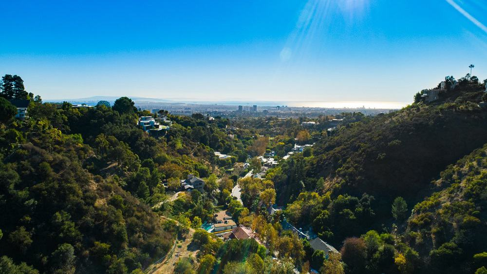 This is an aerial view of the view the property affords. It has a sweeping view of the canyon, the city and the sea beyond in the far distance. Image courtesy of Toptenrealestatedeals.com.