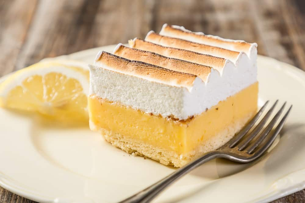 This is a piece of lemon cream cheese bar on a plate.