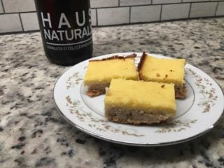 Three pieces of lemon cream cheese bars on a plate.