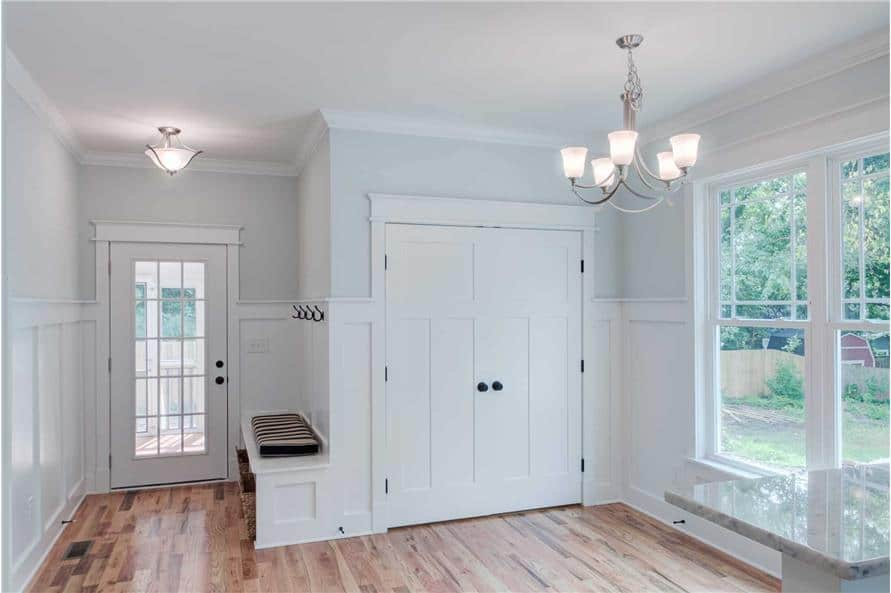 Mudroom with a built-in bench and a glazed door that leads to the screened porch.