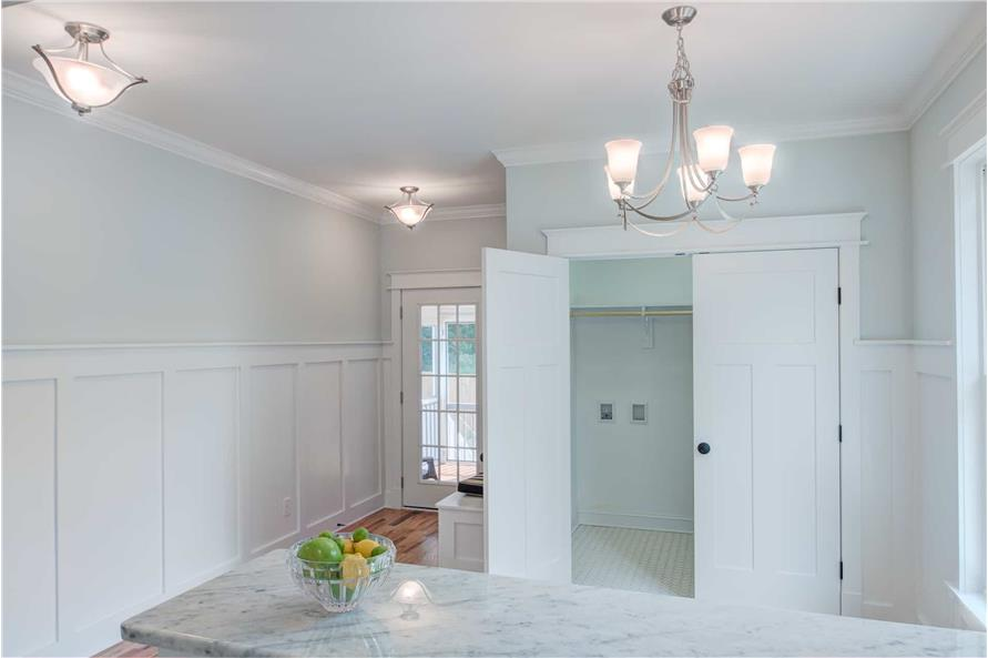 A white double door across the snack bar opens to the utility room.