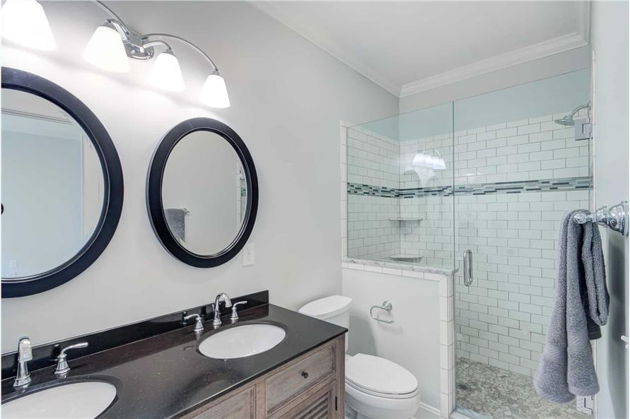 Walk-in shower and toilet complete the primary bathroom.