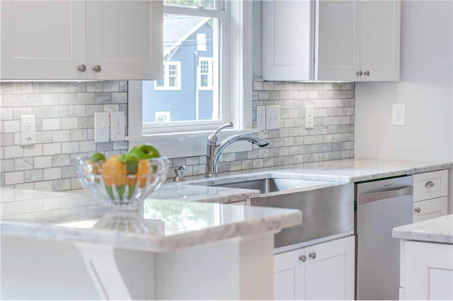A closer look at the farmhouse sink paired with chrome fixtures.