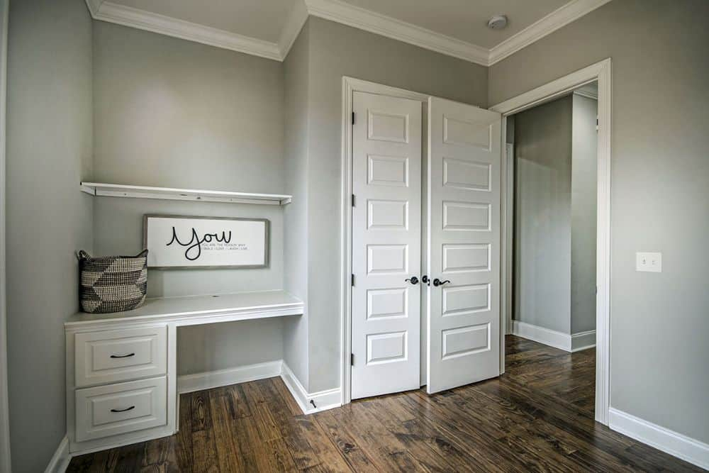 The bedroom includes a walk-in closet and a built-in desk.