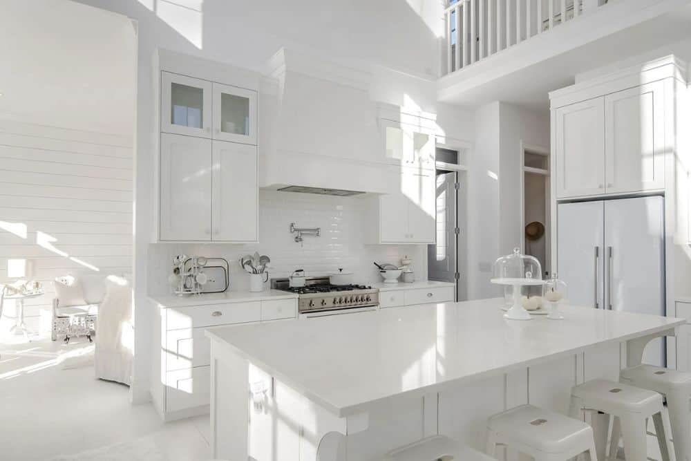 The kitchen includes a white fridge tucked in the cabinets.